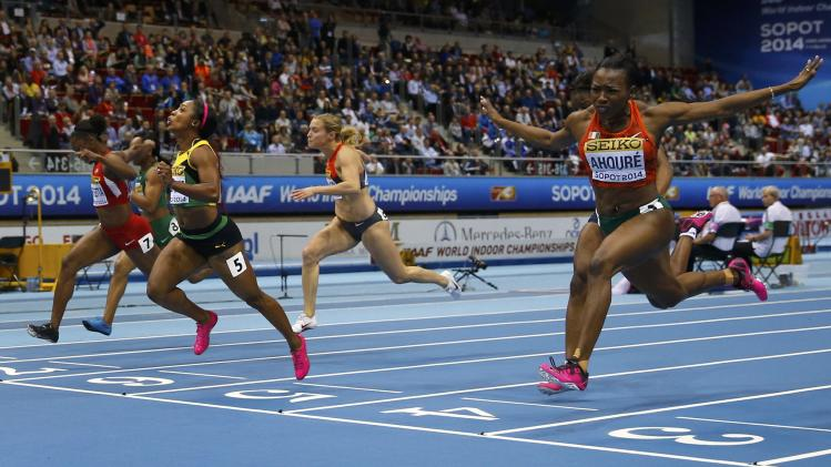 Jamaica's Fraser-Pryce crosses finish line to win women's 60m final at world indoor athletics championships in Sopot