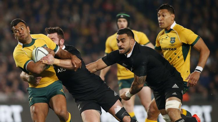 Beale of Australia Wallabies is tackled by Crotty of New Zealand's All Blacks during their second Bledisloe Cup rugby championship match at Eden Park in Auckland