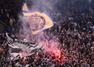 Supporters cheer Brazil's Corinthians in Yokohama on December 16, 2012. A Corinthians teenage fan has confessed to causing the flare death of a 14-year-old during the Sao Paulo side's Libertadores Cup game in Bolivia last week