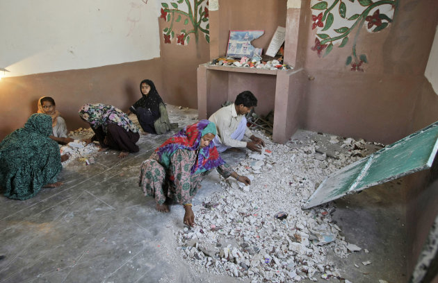 Hindus clean a temple after being attacked by a group of Muslim men in Karachi, Pakistan, Sunday, Sept. 30, 2012. A group of Muslims suspected of ransacking a Hindu temple in southern Pakistan may be charged with blasphemy, police said Sunday. The case is a rare twist on the use of the country&#39;s harsh blasphemy laws, which are more often invoked against supposed offenses to Islam as opposed to minority faiths. (AP Photo/Fareed Khan)
