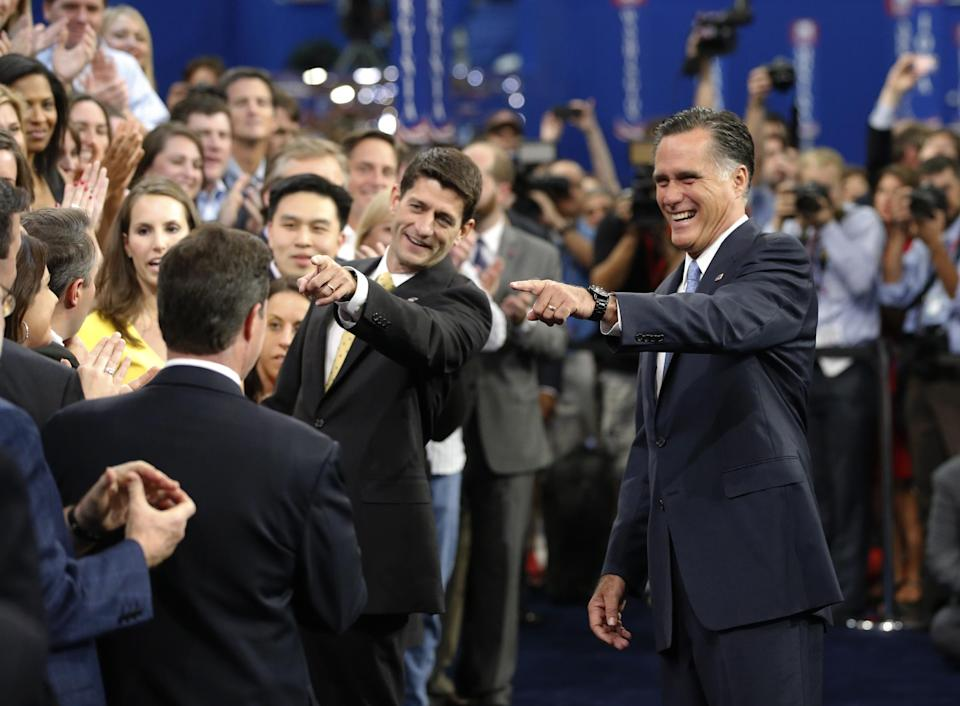 Republican presidential nominee Mitt Romney, right, and Republican vice presidential nominee, Rep. Paul Ryan laugh with their campaign staff as they gather for a group picture at the Republican National Convention in Tampa, Fla., on Thursday, Aug. 30, 2012. (AP Photo/Jae C. Hong)