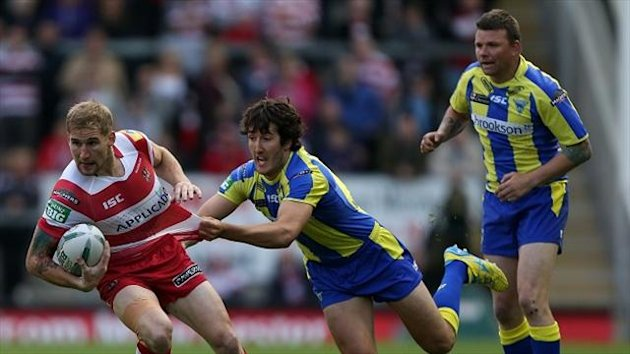 Sam Tomkins, left, scored his 23rd try of the season against Warrington on Monday night
