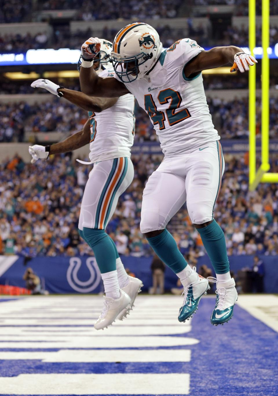 Miami Dolphins fullback Charles Clay (42) celebrates a touchdown against the Indianapolis Colts with wide receiver Davone Bess during the first half of an NFL football game in Indianapolis, Sunday, Nov. 4, 2012. (AP Photo/Darron Cummings)