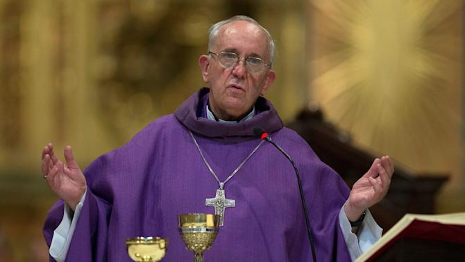 This Feb. 14, 2013 photo shows Archbishop of Buenos Aires, Cardinal Jorge Mario Bergoglio leading a mass at the Metropolitan Cathedral in Buenos Aires, Argentina.  (AP Photo/Natacha Pisarenko)