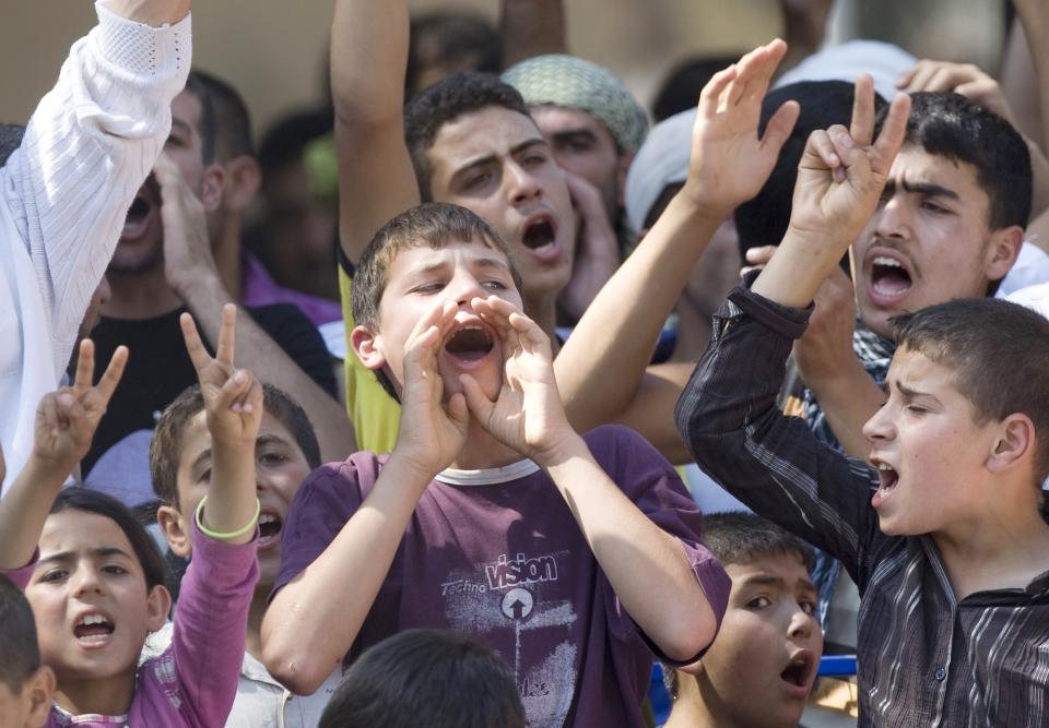 Syrian refugees, mostly teenagers, demonstrate against their country's regime and its leader Bashar al-Assad, in a camp in the Turkish border town of Yayladagi in Hatay province, Turkey, Wednesday, June 29, 2011.(AP Photo/Burhan Ozbilici)