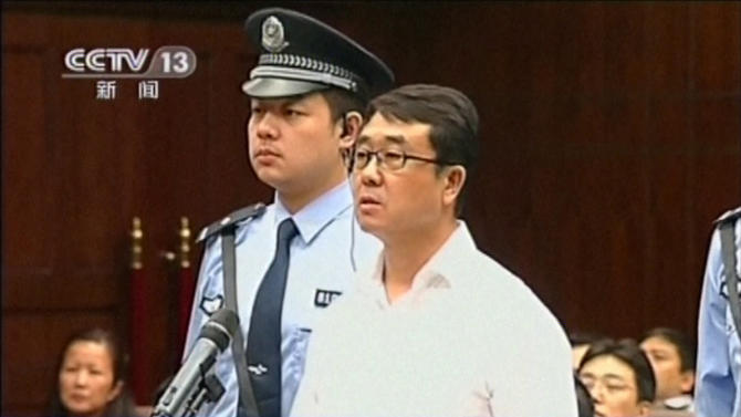 CORRECTS DATE - In this Sept. 18, 2012 video image taken from CCTV, Wang Lijun speaks during his trial at the Chengdu Intermediate People's Court in Chengdu, southwest China's Sichuan province,.   Wang, the Chinese police chief whose thwarted defection exposed murder and infighting in high places was sentenced to 15 years in prison Monday, Sept. 24, 2012, setting the stage for China's leadership to close out the divisive scandal and move ahead with a generational handover of power. (AP Photo/CCTV via AP video) CHINA OUT, TV OUT