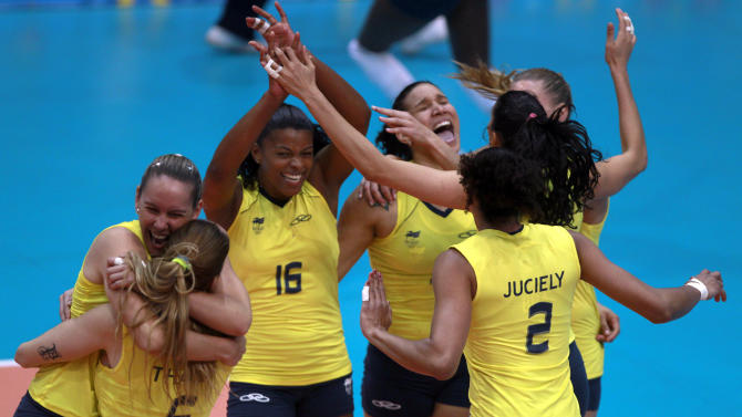 Brazil's players celebrate after beating Cuba in the women's volleyball gold medal match during the Pan American Games in Guadalajara, Mexico, Thursday, Oct. 20, 2011. (AP Photo/Dario Lopez-Mills)