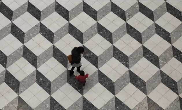 A girl and her mother walk in a building in Tokyo