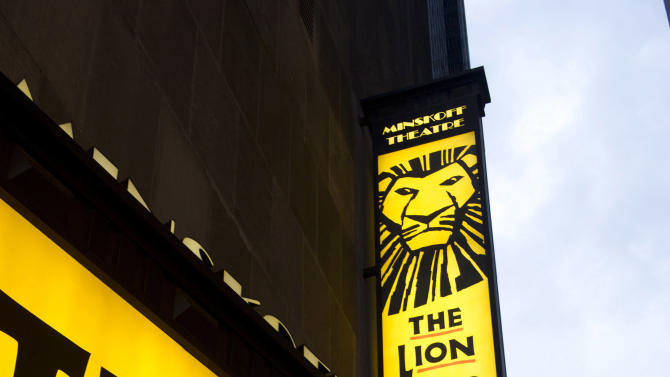 """FILE - In this Jan. 19, 2012 file photo, the Minskoff Theatre and the marquee for """"The Lion King"""" are displayed in New York.  With a worldwide gross of over $6.2 billion, """"The Lion King"""" stage musical has now achieved the most successful box office total of any work in any media in entertainment history. (AP Photo/Charles Sykes, File)"""