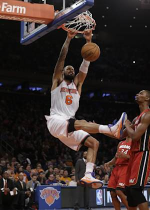 New York Knicks center Tyson Chandler (6) dunks in front of Miami Heat center Chris Bosh (1) during the first half of their NBA basketball game at Madison Square Garden in New York, Sunday, March 3, 2013. (AP Photo/Kathy Willens)
