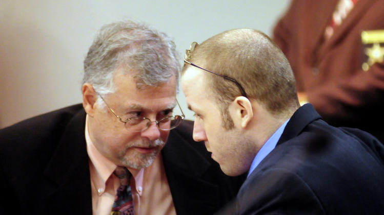 Jerry Word of the Office of the Georgia Capital Defender, left, talks to Guy Heinze, Jr. when the jury came out to watch a video of the crime scene walk through earlier today, Thursday, October 24, 2013, in Glynn County Superior Court in Brunswick, Ga. Heinze is accused of killing his father and seven other people in a mobile home park in Glynn County in August, 2009. (AP Photo/The Brunswick News/Michael Hall, POOL)