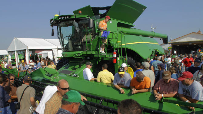 JIn this Aug. 31, 2011 photo, a John Deere columbine is displayed during the Farm Progress Show, in Decatur, Ill. A slump in demand for autos and primary metals pushed orders for long-lasting manufactured goods down in August following a big increase in July. The August setback underscored that the manufacturing sector has slowed in response to weak consumer demand. (AP Photo/Seth Perlman)