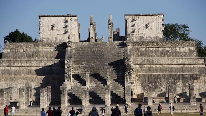 "People gather in front of  ""Templo de los Guerreros,"" or ""Temple of the Warriors,"" in Chichen Itza, Mexico, Thursday, Dec. 20, 2012. Doomsday hour is here, at least in much of the world, and so still are we. According to legend, the ancient Mayans' long-count calendar ends at midnight Thursday, ushering in the end of the world. Didn't happen. (AP Photo/Israel Leal)"