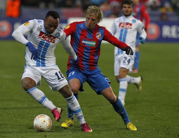 Zuniga of Napoli challenges Rajtoral of Viktoria Plzen during their Europa League soccer match in Plzen