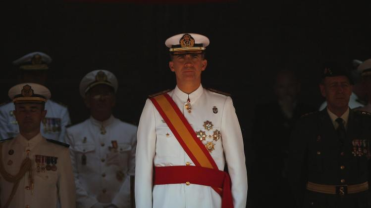 Spain's King Felipe VI looks on as he presides over the graduation ceremony for new sergeants promoted from the 75th Royal Navy NCO course and 24th Corps of Military Musicians course, at the NCO School of the Spanish Navy in San Fernando