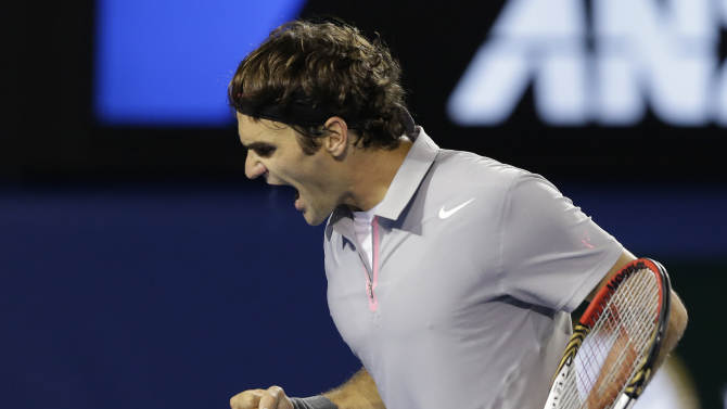 Switzerland's Roger Federer reacts after winning the second set of his men's semifinal against Britain's Andy Murray at the Australian Open tennis championship in Melbourne, Australia, Friday, Jan. 25, 2013. (AP Photo/Andy Wong)