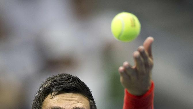 Djokovic of Serbia serves to Haider-Maurer of Austria during their second round match at the U.S. Open Championships tennis tournament in New York