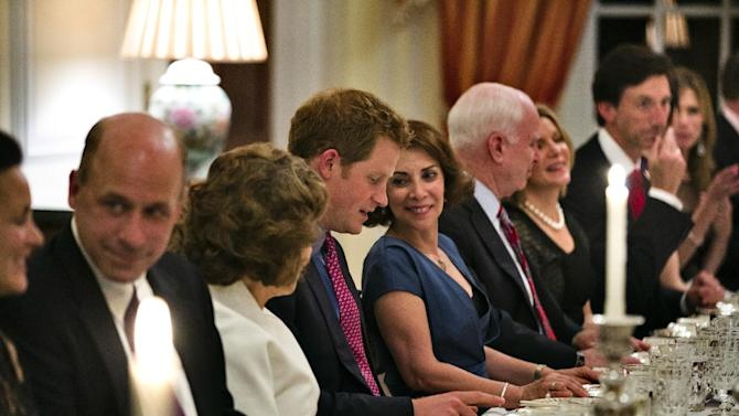 Britain's Prince Harry sits down to dinner at the Ambassador's residence in Washington, Thursday, May, 9, 2013, with Teresa Heinz, center left, wife of Secretary of State John Kerry, and the wife of the British Ambassador to the U.S. Lady Westmacott. (AP Photo/Jim Lo Scalzo, Pool)