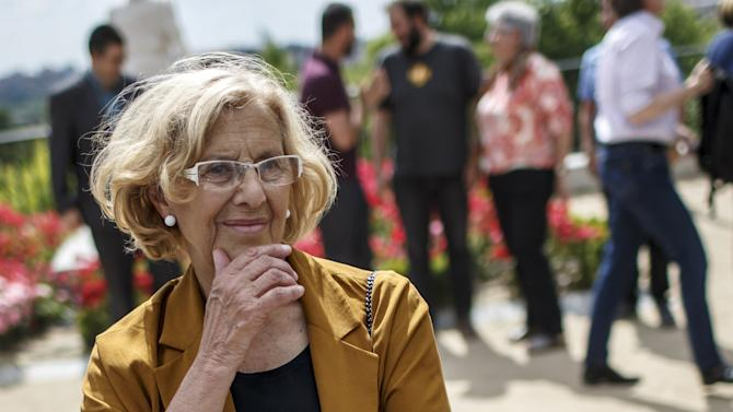 Ahora Madrid (Now Madrid) local candidate Manuela Carmena poses for the media in central Madrid