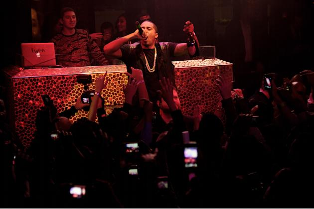 IMAGE DISTRIBUTED FOR TAO - Hip Hop icon, Nas, performs at TAO Nightclub on Friday, Dec. 28, 2012, in Las Vegas. (Photo by Al Powers/Invision/AP)
