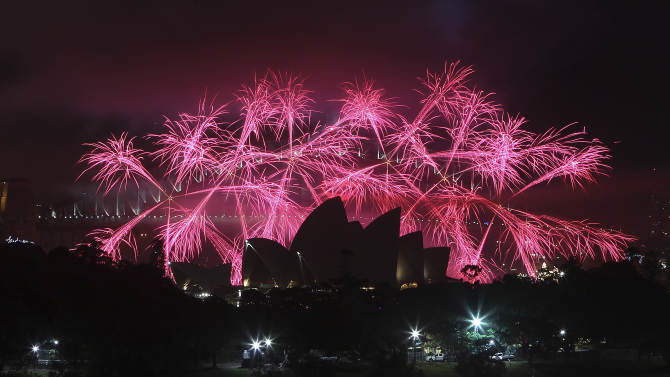 Fireworks explode behind the Opera House during the New Year celebrations in Sydney, Australia, Tuesday, Jan. 1, 2013.(AP Photo/Rob Griffith)