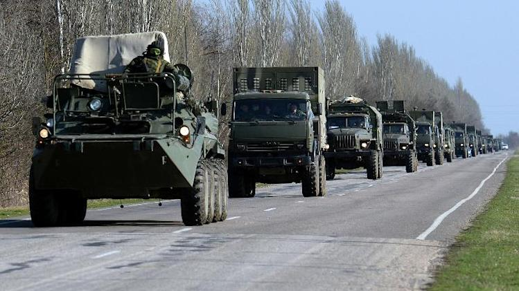 Russian forces drive on a highway near the Ukrainian town of Dzhankoy on March 15, 2014