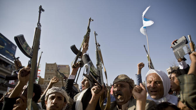 Shiite rebels, known as Houthis, hold up their weapons to protest against Saudi-led airstrikes, during a rally in Sanaa, Yemen, Wednesday, April 1, 2015. Saudi-led coalition warplanes bombed Shiite rebel positions in both north and south Yemen early Wednesday, setting off explosions and drawing return fire from anti-aircraft guns. (AP Photo/Hani Mohammed)