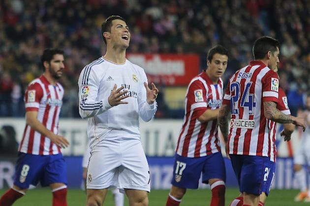Real's Cristiano Ronaldo, centre, gestures during a semi final, 2nd leg, Copa del Rey soccer match between Atletico de Madrid and Real Madrid at the Vicente Calderon stadium in Madrid, Spain, Tues