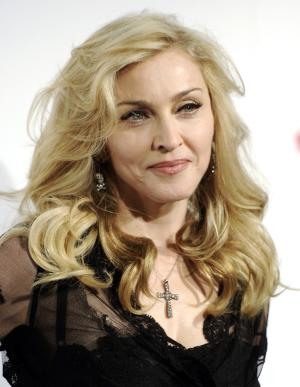 FILE - In this April 12, 2012, file photo, Madonna arrives at Macy's Herald Square in New York. A former firefighter with a crush on Madonna has been sentenced Wednesday, Jan. 2, 2013 to three years' probation for resisting arrest outside the singer's New York City apartment building. Robert Linhart was convicted in November after being twice arrested in September 2010. (AP Photo/Evan Agostini, File)