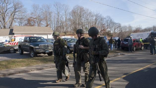 Connecticut State Police walk near the scene of an elementary school shooting on December 14, 2012 in Newtown, Connecticut -- Getty Images