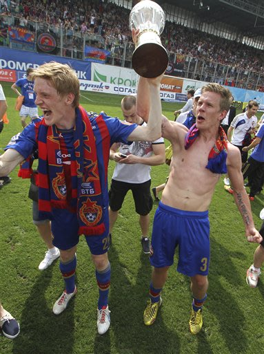 CSKA Moscow's Rasmus Elm and Pontus Verblum, both from Sweden, celebrate with team's trophy after a Russian Premier League Championship soccer match between CSKA Moscow and Kuban, at the Arena Khimki 