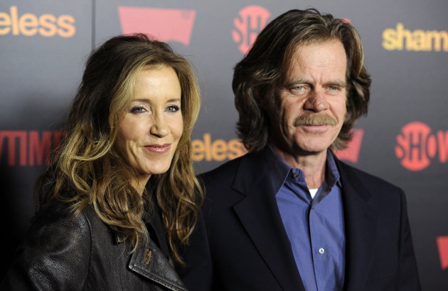 "FILE - In this Jan. 5, 2012 file photo, William H. Macy, a cast member in ""Shameless,"" poses with his wife, actress Felicity Huffman, at the premiere of the second season of the Showtime television series in Los Angeles. The second season of ""Shameless,"" premiered Sunday, Jan. 8, 2012 on Showtime. (AP Photo/Chris Pizzello, file)"