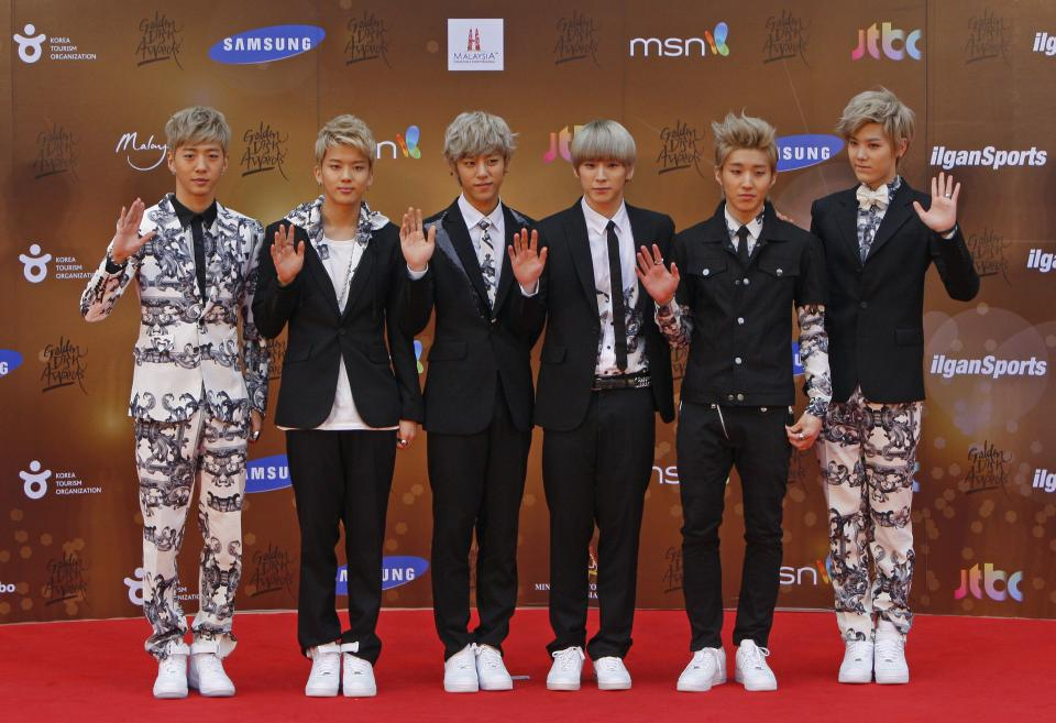 South Korean boy band B.A.P pose for photographers as they arrive on the red carpet ahead of the 27th Golden Disk Awards at Sepang International Circuit in Sepang, Malaysia, Wednesday, Jan. 16, 2013. (AP Photo/Lai Seng Sin)