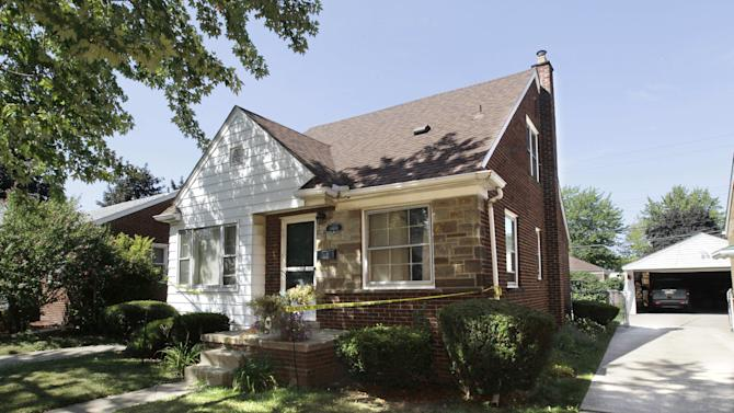 The house of a man and a woman whose decapitated bodies were pulled from the Detroit River and a creek in Detroit is shown in Allen Park, Mich., Friday, July 20, 2012. (AP Photo/Carlos Osorio)