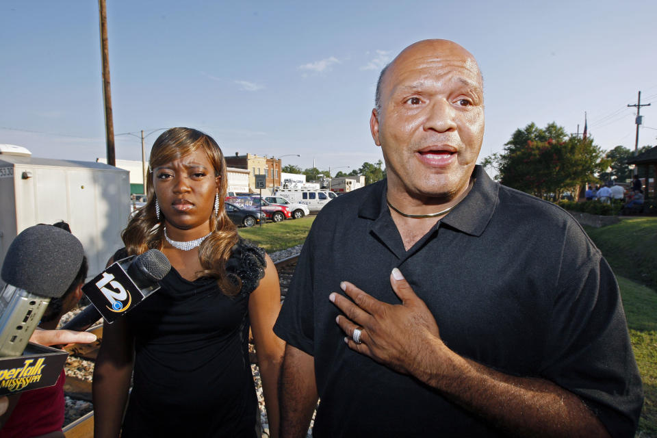 Charles and Te'Andrea Wilson speak to reporters following prayer rally in support of racial reconciliation Monday, July 30, 2012 in Crystal Springs, Miss., following the actions of some congregants at the First Baptist Church which prevented a black couple from getting married there. (AP Photo/Rogelio V. Solis)