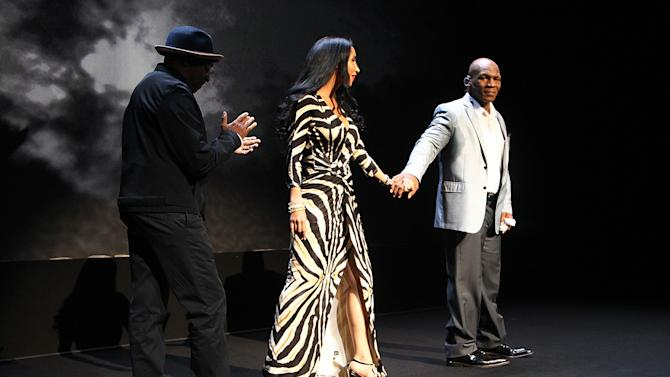 """Director Spike Lee, left, Lakiha Tyson, center, and her husband and former boxer Mike Tyson takes part in a curtain call following his 'Mike Tyson: Undisputed Truth"""" performance on Thursday, Aug. 2, 2012, in New York. (Photo by Donald Traill/Invision/AP)"""