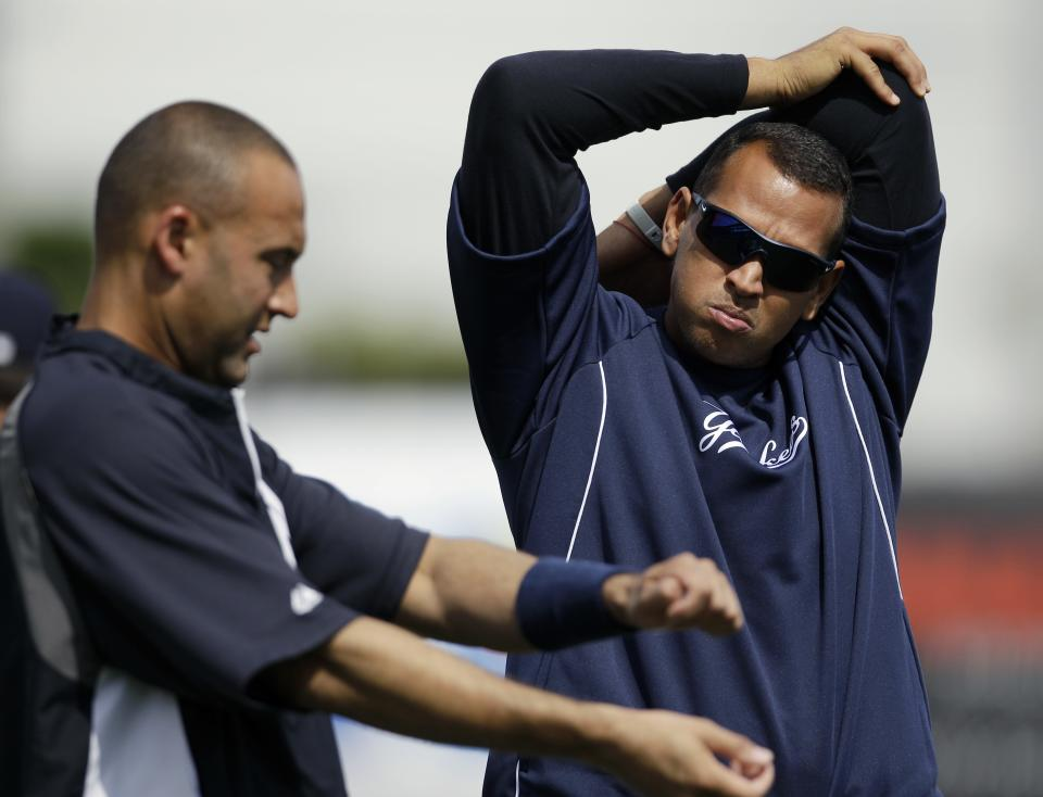 New York Yankees' Alex Rodriguez, right, and Derek Jeter stretch during practice at baseball spring training, Saturday, Feb. 25, 2012, in Tampa, Fla. (AP Photo/Matt Slocum)