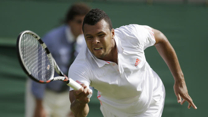 Jo-Wilfried Tsonga of France returns a shot to Guillermo Garcia-Lopez of Spain during a second round men's singles match at the All England Lawn Tennis Championships at Wimbledon, England, Thursday, June 28, 2012. (AP Photo/Alastair Grant)