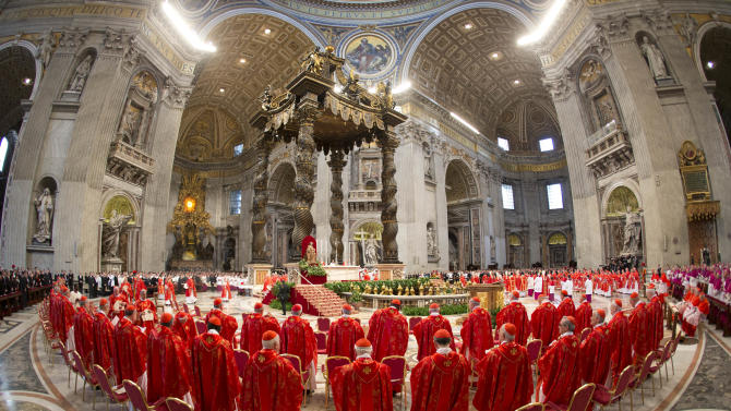 Cardinals attend a Mass for the election of a new pope celebrated by Cardinal Angelo Sodano inside St. Peter's Basilica, at the Vatican, Tuesday, March 12, 2013. Cardinals enter the Sistine Chapel on Tuesday to elect the next pope amid more upheaval and uncertainty than the Catholic Church has seen in decades: There's no front-runner, no indication how long voting will last and no sense that a single man has what it takes to fix the many problems. (AP Photo/Andrew Medichini)
