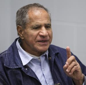 Sirhan Sirhan, now 66, convicted of assassinating Sen. Robert F. Kennedy in 1968, gestures during a Board of Parole Suitability Hearing Wednesday, March 2, 2011, at the Pleasant Valley State Prison in Coalinga, Calif.  A panel of two California parole board commissioners denied parole to Sirhan. (AP Photo/Ben Margot)