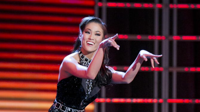 "This photo courtesy Miss America Organization shows Miss Oklahoma Alicia Clifton's tap dance performance to ""Money Can't Buy Me Love"" that earned her top honors on Jan. 8, 2013, at the Planet Hollywood Resort & Casino in Las Vegas.  Clifton, Miss Oklahoma and Ali Rogers Miss South Carolina have racked up prizes in the first day of preliminary Miss America competition in Las Vegas. (AP Photo/Courtesy B. Vartan Boyajian/MAO)"