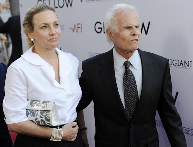 "FILE - In this July 27, 2010 file photo, producer, Richard Zanuck, and his wife Lili Fini Zanuck arrive at the premiere of the film ""Get Low"" in Beverly Hills, Calif. According to his publicist, Richard D. Zanuck has died at age 77 in Los Angeles on Friday, July 13, 2012. He won an Oscar for best picture for his film, ""Driving Miss Daisy."" (AP Photo/Chris Pizzello, File)"