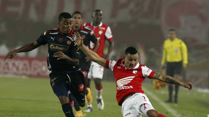 Luis Carlos Arias  of Santa Fe fights for the ball against Carlos Valencia of Medellin during the Colombian first division championship in Bogota