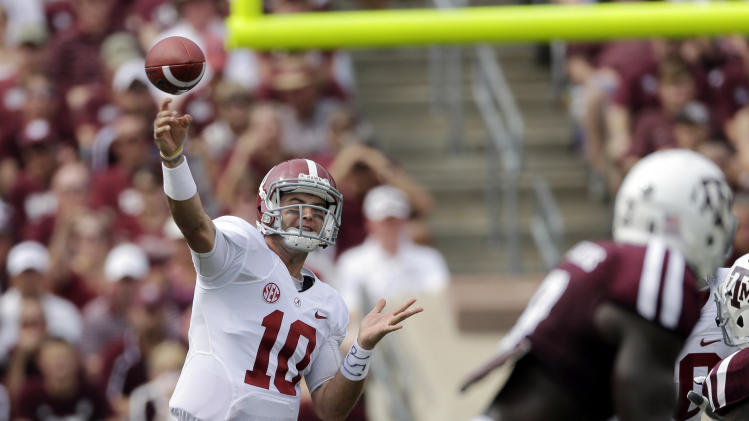 FILE - In this Sept. 14, 2013, file photo, Alabama quarterback AJ McCarron (10) throws a pass against Texas A&M during the second quarter of an NCAA college football game in College Station, Texas. McCarron was selected by the Cincinnati Bengals in the fifth round, 164th overall, in the 2014 NFL Draft on Saturday, May 10, 2014.(AP Photo/David J. Phillip)