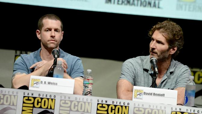 """D.B. Weiss, left, and David Benioff participate in the """"Game of Thrones"""" panel on Day 3 of 2013 Comic-Con International on Friday, July 19, 2103, in San Diego. (Photo by Jordan Strauss/Invision/AP)"""