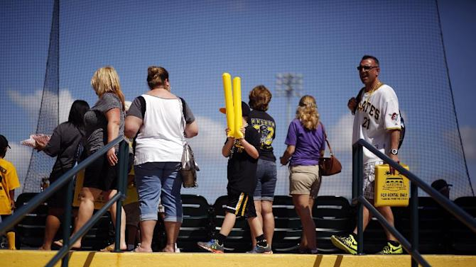 Baseball fans make their way to their seats  at McKechnie Field before the Pittsburgh Pirates Black and Gold intrasquad spring training baseball game in Bradenton, Fla., Monday, March 2, 2015. Alvarez did not play in the game. (AP Photo/Gene J. Puskar)