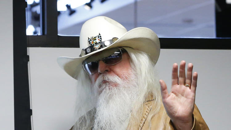 Leon Russell waves as he is introduced in in Tulsa, Okla., Tuesday, Jan. 29, 2013. The Oklahoma Historical Society has acquired a large collection of works by the legendary musician and native Oklahoman that are intended for display in a planned pop culture museum in Tulsa. (AP Photo/Sue Ogrocki)
