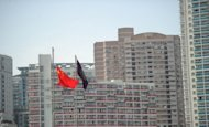 High rise apartments in Shanghai in May 2012. China vowed Friday to maintain tight controls over the country's property market after house sales recently picked up despite a slowing economy