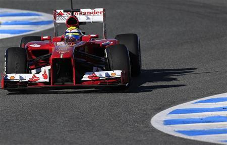 Ferrari Formula One driver Massa takes a curve as he drives the new F138 during a training session at the Jerez racetrack in southern Spain