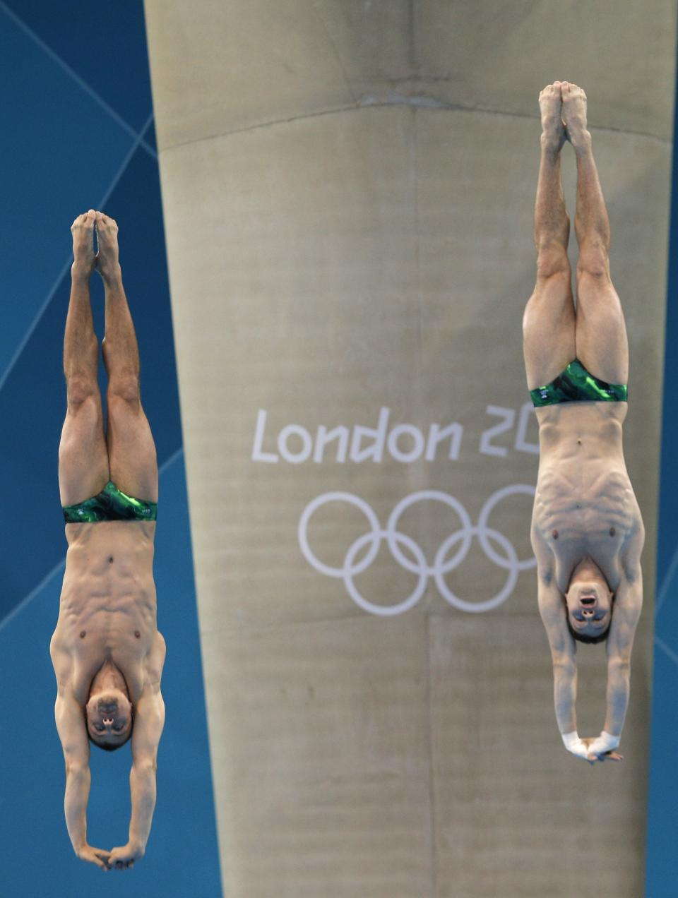 Sascha Klein, left, and Patrick Hausding of Germany compete during the Men's Synchronized 10 Meter Platform Diving final at the Aquatics Centre in the Olympic Park during the 2012 Summer Olympics in London, Monday, July 30, 2012. (AP Photo/Christophe Ena)